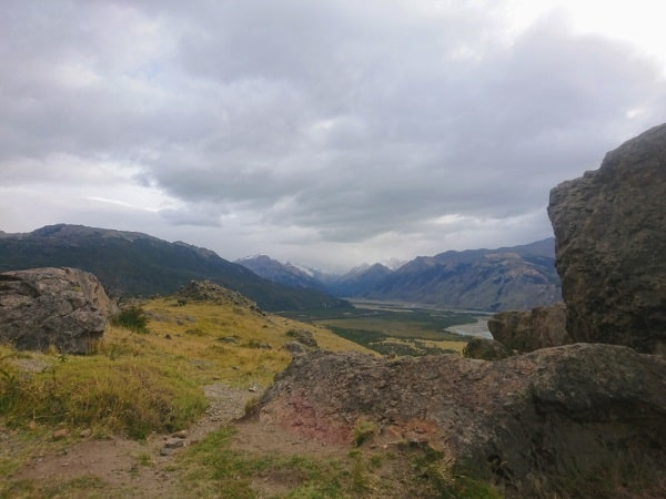 Views of rocks, mountains and a river valley.